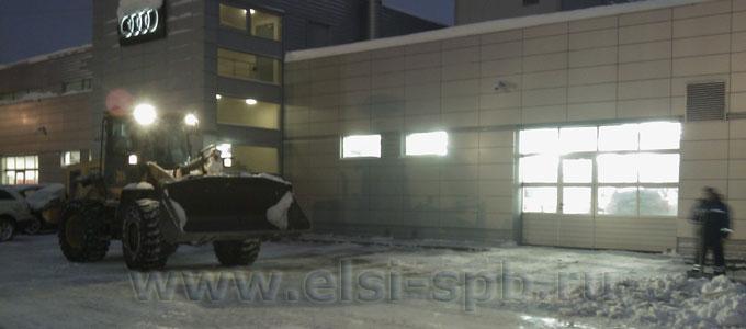 Уборка снега на территории автосалона Audi